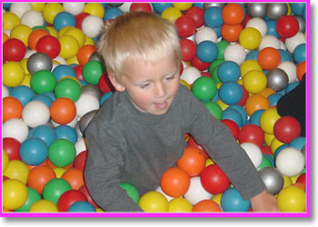 Tom in the smugglers ball pool